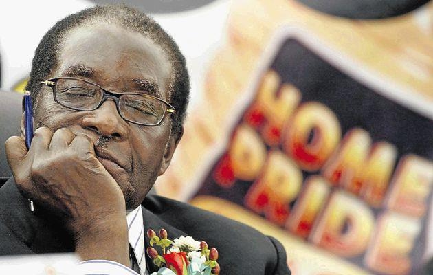 Mugabe remained expressionless