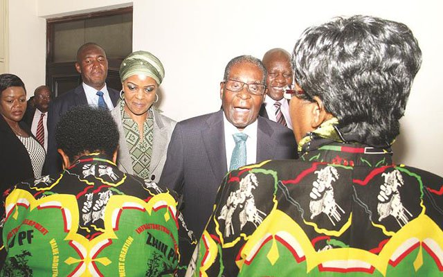 zanu-pf President and First Secretary President Mugabe, flanked by First Lady and zanu-pf secretary for Women's Affairs Amai Grace Mugabe, shares a lighter moment with Politburo members Cdes Cleveria Chizema (left) and Sithokozile Mathuthu on arrival for the organ's meeting at the party's national headquarters in Harare yesterday. — (Picture by Kudakwashe Hunda)