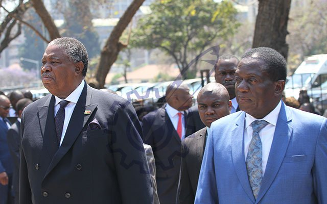Vice President Emmerson Mnangagwa and Vice President Mphoko arrive at the opening of the Fifth Session of the Eighth Parliament