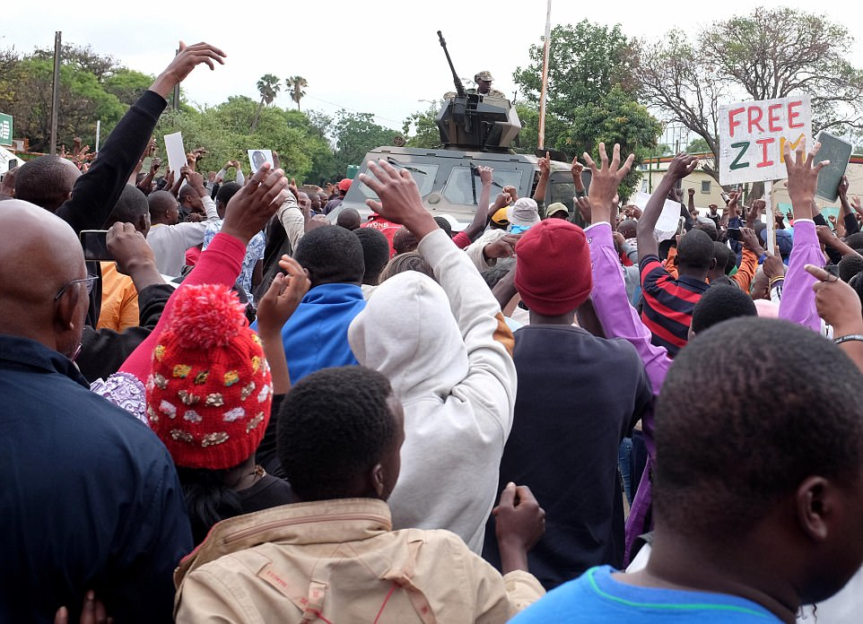 Ecstatic crowds marched through central Harare, cheering and hugging soldiers, honking horns, dancing, and singing