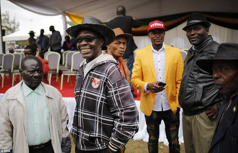 Members of the powerful war veterans, traditionally a source of support for Mugabe, stand guard at the stage prior to the mass action protests