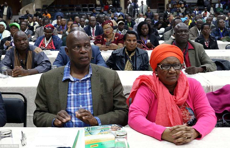 While Mugabe has been removed from his role of Zanu-PF party leader, his title as Zimbabwean president remains. Pictured above, delegates attend a meeting on Sunday to dismiss Mugabe as leader