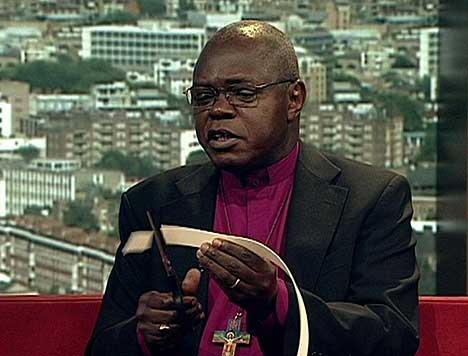 UK archbishop puts collar back on after Mugabe's fall