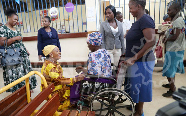 First Lady Auxillia Mnangagwa engages Gogo Siboniso Nyakurwa during a surprise visit at Harare Central Hospital to acquaint herself with the institution's operations yesterday. — (Picture by Believe Nyakudjara)