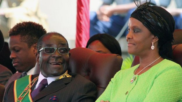 "Zimbabwe""s President Robert Mugabe and his wife Grace attend a Defence Force Day rally in Harare, Zimbabwe August 12, 2014"