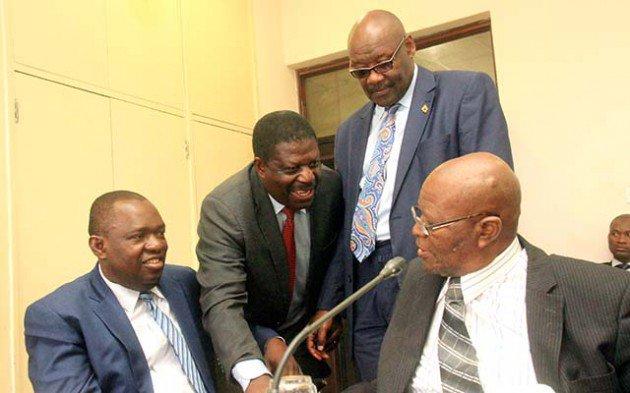 ZANU PF Politburo members Cde's Sibusiso Moyo,Mike Bimha, Dr Parirenyatwa and Joshua Malinga before a Politburo meeting at the party headquarters in Harare yesterday.-Picture by Munyaradzi Chamalimba