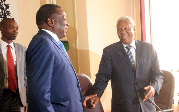 President Emmerson Mnangagwa shares a lighter moment with Cde Sydney Sekeramai at a Poilitburo meeting held ta the ZANU PF headquarters in Harare yesterday.-Picture by Munyaradzi Chamalimba