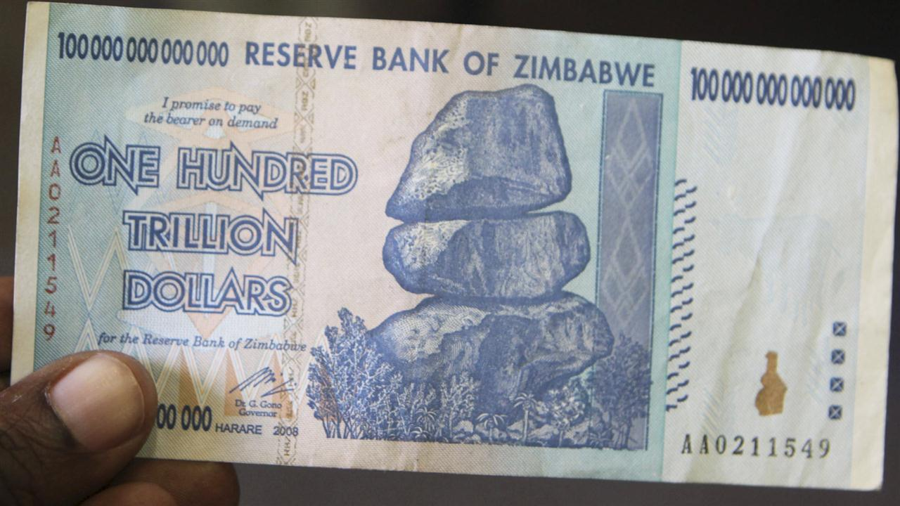Police arrest man in possession of distinctive notes, including a one hundred trillion dollar note in Zimbabwean currency