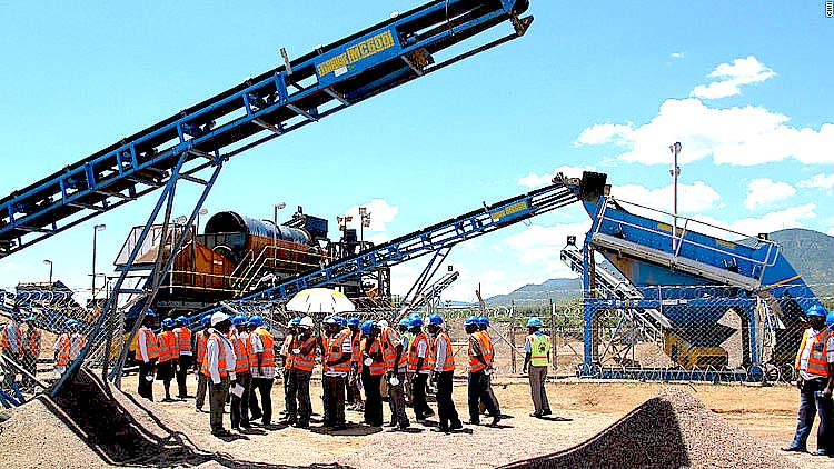 Diamond experts inspect equipment at a mine in Chiadzwa