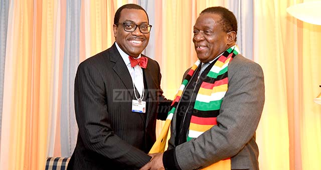 President Mnangagwa chats with president of the African Development Bank (AfDB), Dr. Akinwumi Adesina on the sidelines of the 48th World Economic Forum in Davos, Switzerland, 25 Januray 2018.