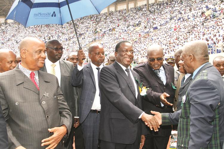 President Mnangagwa greets Zion Christian Church elders while flanked by the church's leader Bishop Nehemiah Mutendi (left) at the National Sports Stadium in Harare yesterday. In the background is the bumper crowd which attended the church's prayer meeting. — (Picture by Tawanda Mudimu)