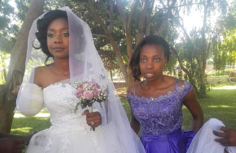 Bride's left hand also injured in croc attack