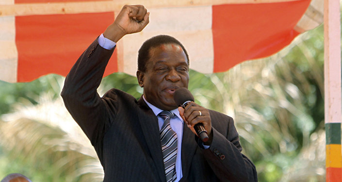 Zimbabwean vice President Emmerson Mnangagwa greets party supporters at the ZANU-PF headquarters in Harare
