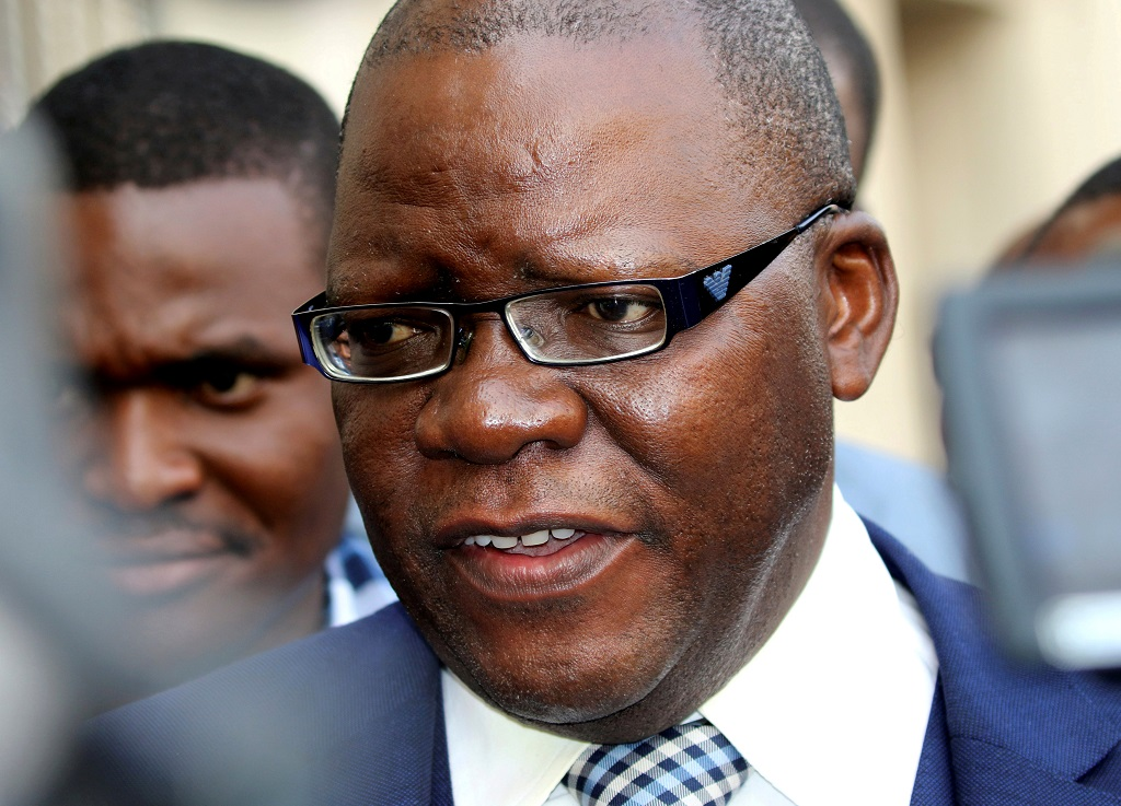 File: Tendai Biti, former finance minister, speaks to journalits after a two-week ban on public protests issued by the police was struck down, outside Zimbabwe's High Court in the capital Harare, September 7, 2016.
