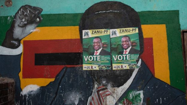 A mural of Robert Mugabe at a Zanu-PF office in Harare, Zimbabwe, with the face covered in two Zanu-PF election posters