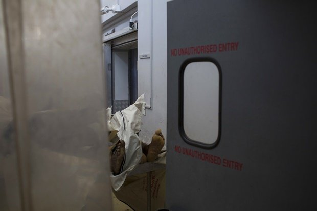 The body of an unidentified man at a mortuary in H