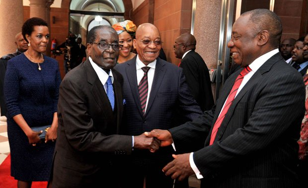 President of Zimbabwe Robert Mugabe greets Deputy President of South Africa Cyril Ramaphosa. (Photo: GCIS)