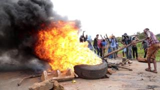 Protesters burning tyres in the Zimbabwean capital Harare