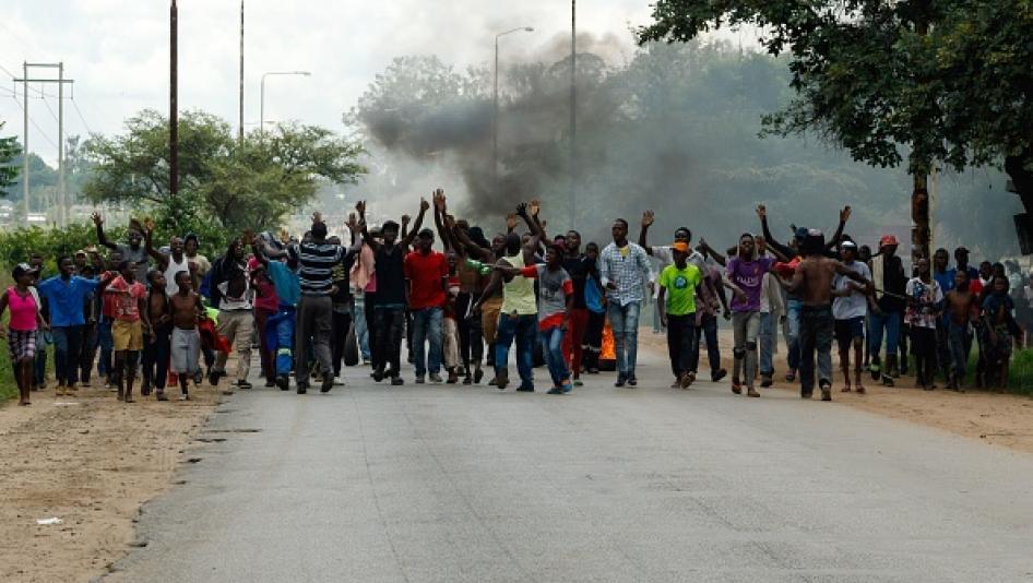 Protesters block the main route to Zimbabwe's capital, Harare, from Epworth township on January 14 2019 after a hike in fuel prices was announced. © 2019 JEKESAI NJIKIZANA/AFP/Getty Images