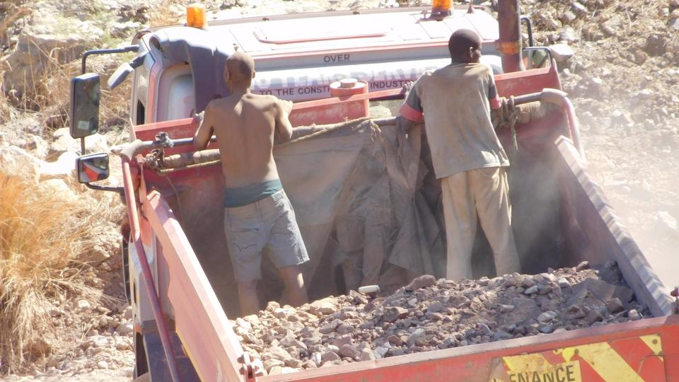 A lorry carries gold ore from the pit at Gaika Mine to a mill for processing.