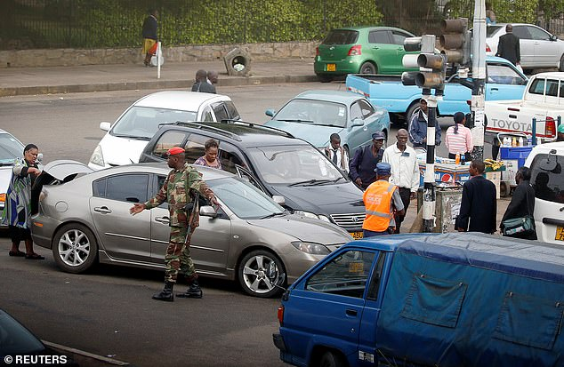 Soldiers and police try to control traffic forming around a petrol station in the capital earlier this week