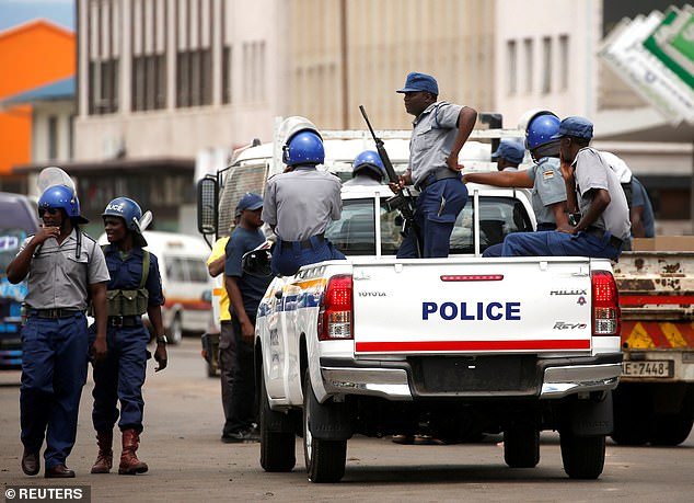 Armed police carrying out patrols on the weekend in the Zimbabwean capital as they cracked down on protestors