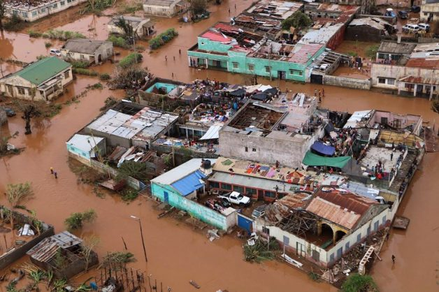Residents stand on rooftops in a flooded area of Buzi, central Mozambique, on March 20, 2019, after the passage of Cyclone Idai. Picture: ADRIEN BARBIER / AFP