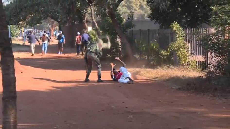 A man is beaten by a Zimbabwean soldier after protests broke out across the country on January 14, 2019.