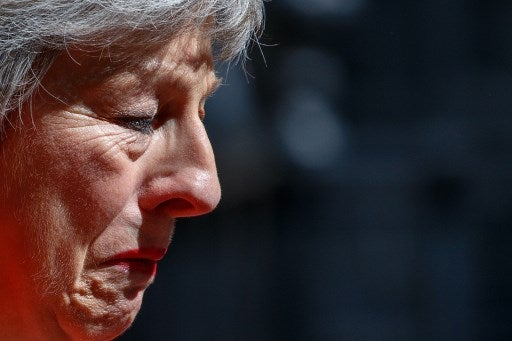 Britain's Prime Minister Theresa May reacts as she announces her resignation outside 10 Downing street in central London on May 24, 2019. - Beleaguered British Prime Minister Theresa May announced on Friday that she will resign on June 7, 2019 following a Conservative Party mutiny over her remaining in power. (Photo by Tolga AKMEN / AFP)