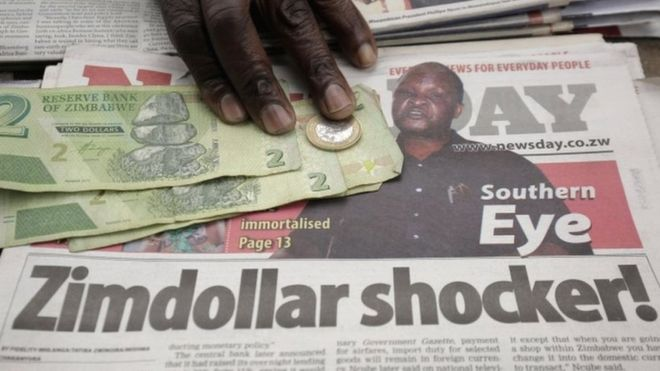 A headline of a local newspaper on the ban of the foreign currency is displayed on a street in Harare, Zimbabwe, 25 June 2019