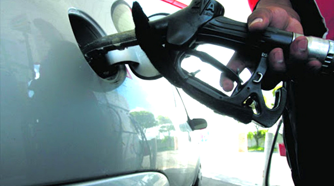 Charging of fuel in US dollars riles motorists