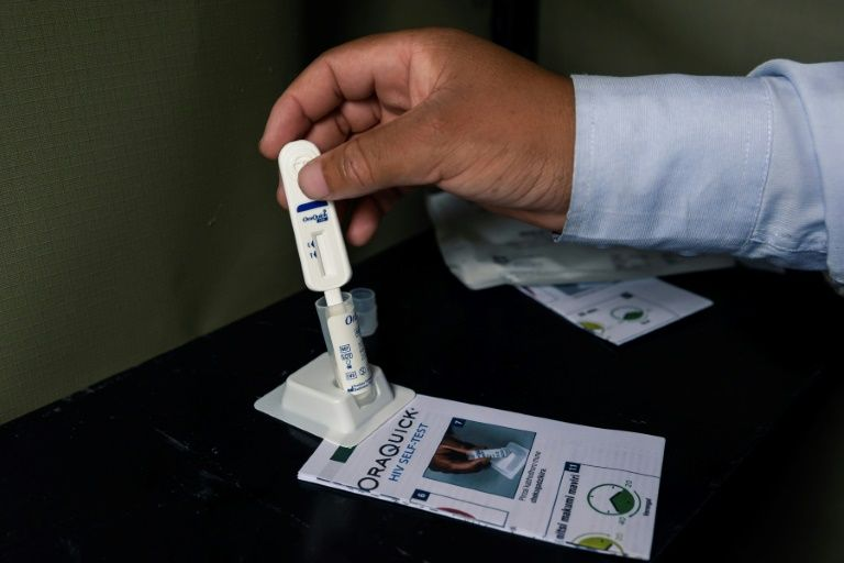 HIV self-testing kits are available at the one-stop clinics (AFP Photo/Jekesai NJIKIZANA)