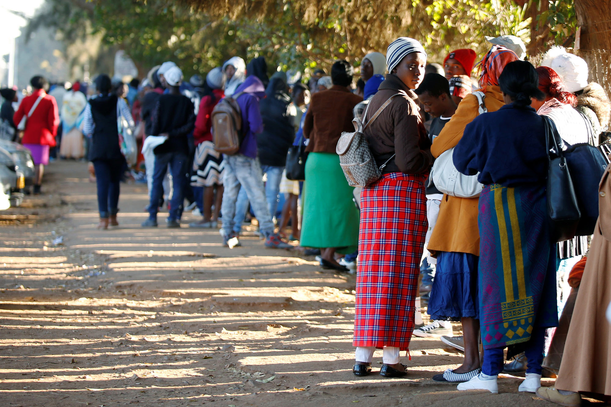 Zimbabweans queue outside a Home Affairs Department office to apply for passports in Harare, Zimbabwe.