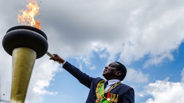 Zimbabwe's President Emmerson Mnangagwa lights the Eternal Flame of Freedom during Zimbabwe Independence Day celebrations at the National Sports Stadium on April 18, 2018 in Harare.