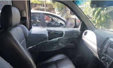 The windows of a vehicle belonging to a former SA Revenue Service high-risk investigation unit member are smashed outside the Durban Sars office, 15 August 2019. Picture: Supplied