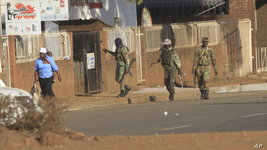 FILE - Soldiers patrol the streets in Harare, Zimbabwe, following demonstrations by opposition party supporters, Aug. 1, 2018.