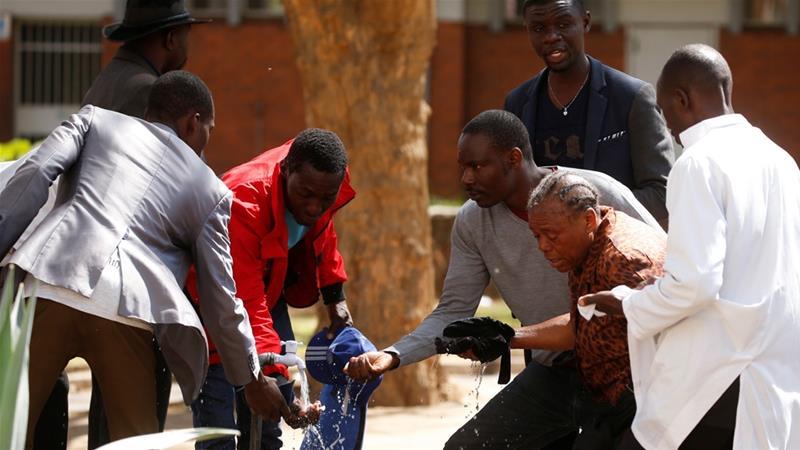 Zimbabwe police violently break up protests after court ban