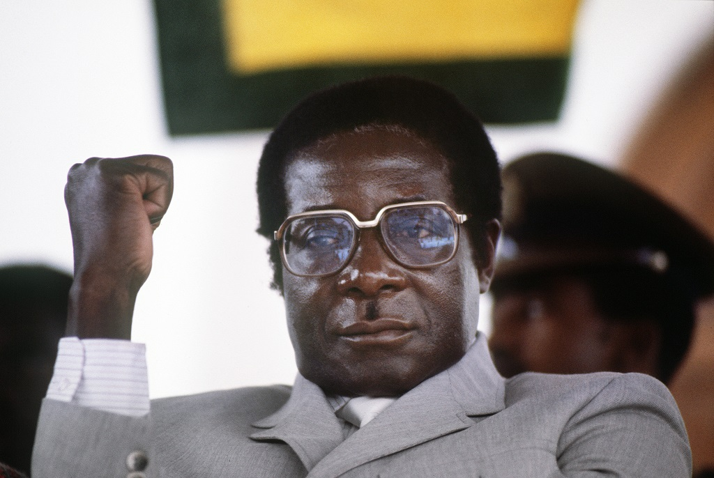 Zimbabwe's Prime Minister Robert Mugabe clenches his fist, in July 1984 in Harare stadium during a meeting.