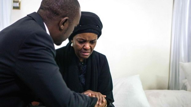 """Movement for Democratic Change opposition party leader Nelson Chamisa (L) offers his condolences to Zimbabwe's former first lady Grace Mugabe, as the body of late president Robert Mugabe lies in state at the Mugabe""""s residency in Harare on September 12, 2019"""