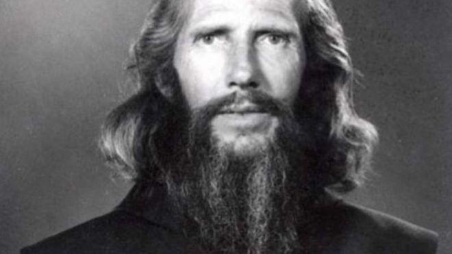 A black-and-white photo portrait of John Bradburne