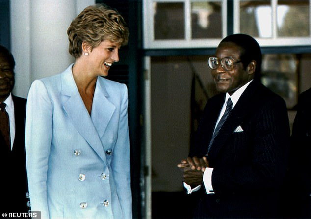 Diana,Princess of Wales talks to Zimbabwean President Robert Mugabe when she visited Harare in 1993