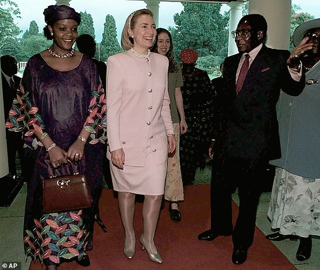 Then US First Lady Hillary Clinton is escorted by Mugabe and Grace in Harare in March 1997