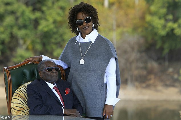 Mugabe and Grace pose for a photo after a press conference at their residence in Harare in July 2018