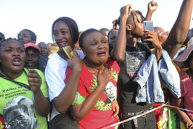 Some of Mugabe's supporters were in tears as they saw the former President's coffin arrive back in the country after he died in Singapore