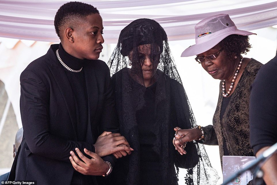 Grace Mugabe (centre), the widow of former Zimbabwe President Robert Mugabe, is escorted by her son Bellermine Chatunga Mugabe (left) as she arrives to attend the official farewell ceremony for her late husband