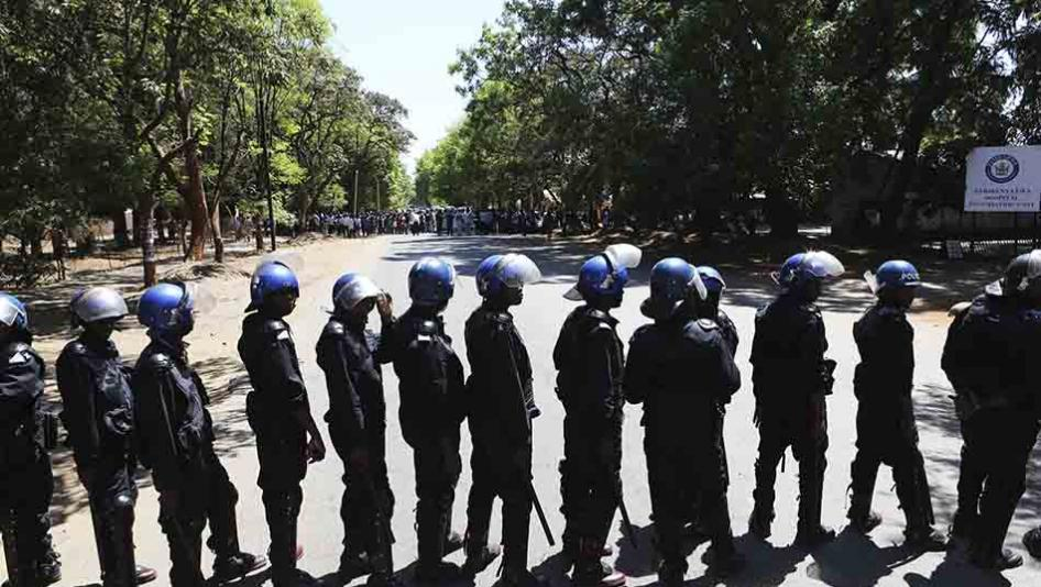 Armed riot police block the road as doctors attempt to march in Harare, Zimbabwe