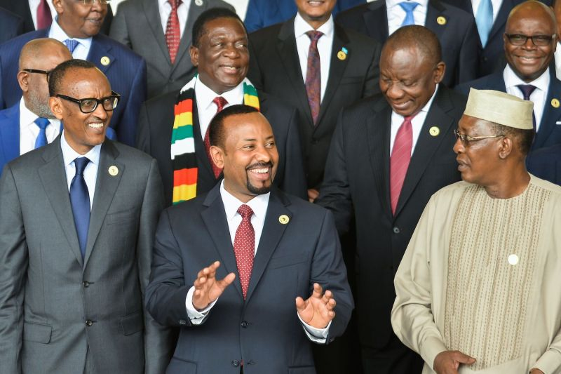 Ethiopian Prime Minister Abiy Ahmed and Zimbabwean President Emmerson Mnangagwa pose for a photo with other African leaders on the sidelines of a African Union summit in Addis Ababa on Nov. 17, 2018.
