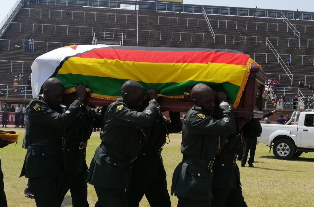 Soldiers carry Robert Mugabes coffin into the Rufaro Stadium