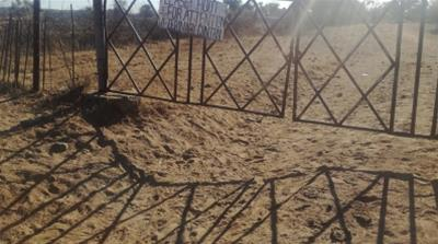 Gate at the former tobacco farmer, Shandu Gumede's farm in Nyamandlovu, Umguza District, in Matabeleland North Province, Zimbabwe that she is now reportedly leasing to a cattle farmer
