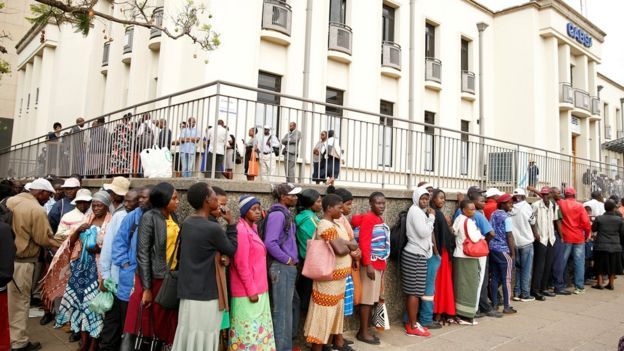 People queuing outside a bank in Harare, Zimbabwe, to get newly released notes - November 2019